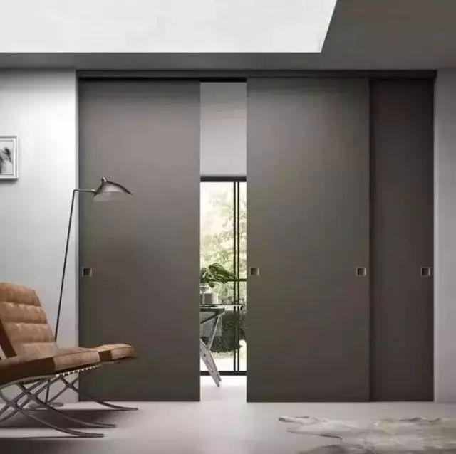 极简风客厅隐藏门装修效果图